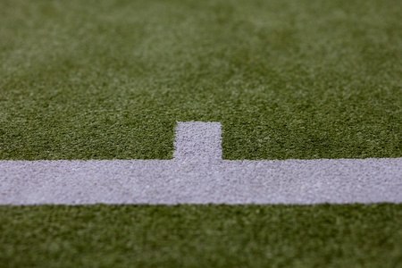 White lines on an astro turf sports court