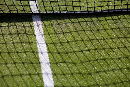 Tennis court net, white line and net on green astro turf Stok Fotoğraf