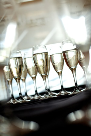 Nine glasses of champagne on a silver tray at a hospitality evening function Stok Fotoğraf