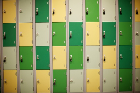 a wall of brown an, cream and biege steel lockers Stok Fotoğraf