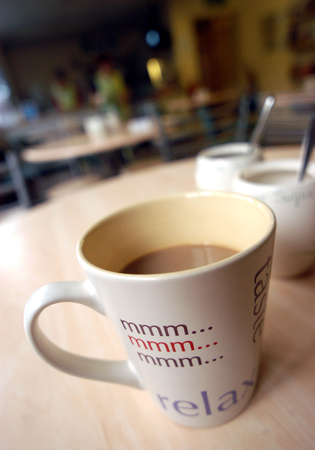 Simple white filter coffee in a basic mug in a cafeteria