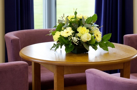 Reception area with floral display and seating in a Funeral directors