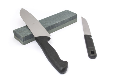 Knife and whetstone Stock Photo