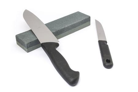 honing: Knife and whetstone Stock Photo