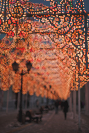 Winter evening  in the town. Bokeh. Blurred yellow, orange, red lights.