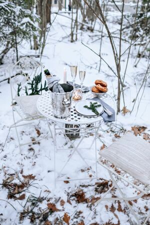 Romantic dinner in the winter forest.