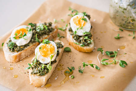 Egg and green pesto sandwiches. Reklamní fotografie