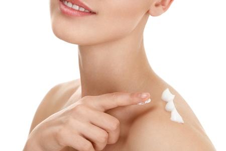 Young woman applying moistyring cream on skin Stock Photo - 15408322