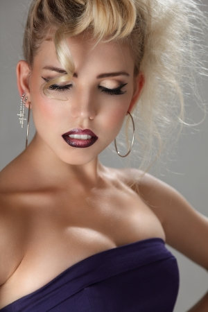 sensual lips: Beautiful blonde young woman with bright make-up studio portrait