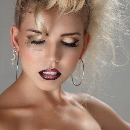 Beautiful blonde young woman with bright make-up studio portrait Stock Photo - 15408362
