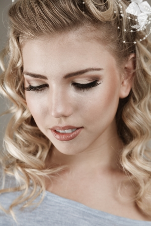 Beautiful blonde young woman with bright make-up studio portrait