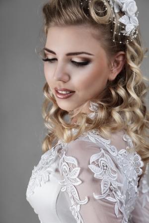 evening wear: Beautiful young bride studio indoor portrait
