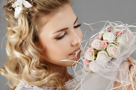 Happy young bride with wedding bouquet Stock Photo