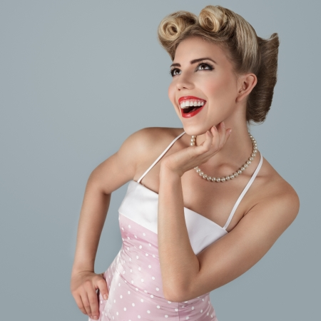 Classic retro style fashion portrait of young blonde pin-up girl studio shot Stock Photo