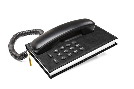 Old office desktop phone with integrated phonebook concept isolated on white background