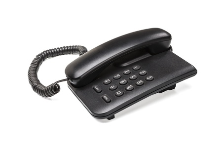 Old office desktop phone isolated on white background Stock Photo