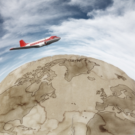 airscrew: Old airplane flying against blue sky over rusted earth map