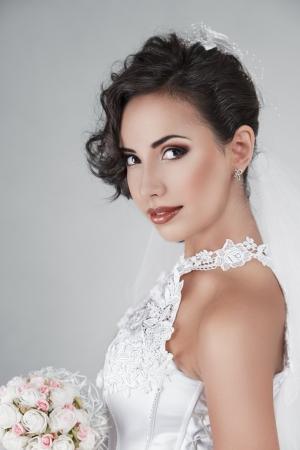 sexy bride: Happy young bride with wedding bouquet Stock Photo