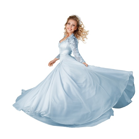 evening gown: Happy young bride in long beautiful dress isolated over white background