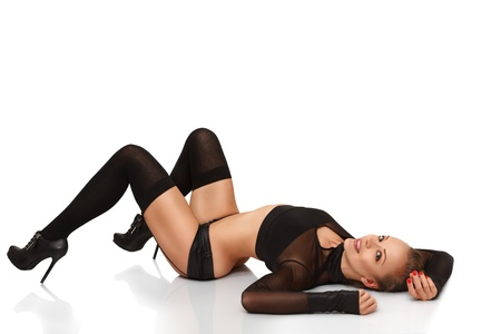 Sexy young blonde woman lying down on back isolated on white background Stock Photo