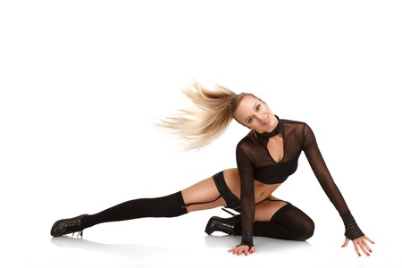 fetish wear: Sexy young blonde woman dancing in night club isolated on white background