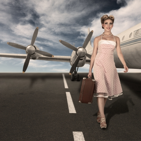 Vintage style classic stewardess portrait walking at runway against old airliner