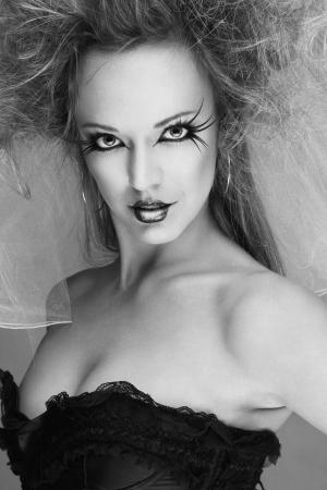Fashion model with long eyelashes and creative make-up studio shot