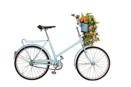 bike wheel: Old retro blue bicycle with flowers bouquet in basket isolated on white background