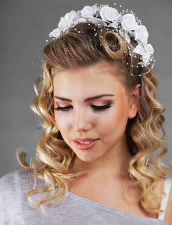 Young woman with beautiful wedding hairstyle decorated with flowers Stock Photo