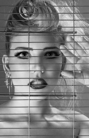 Fashion beautiful woman inside jail cell art portrait Stock Photo