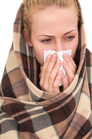 hanky: A woman with a symptoms cold flu allergy wiping or blowing her nose