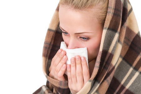 girl blowing: A woman with a symptoms cold flu allergy wiping or blowing her nose