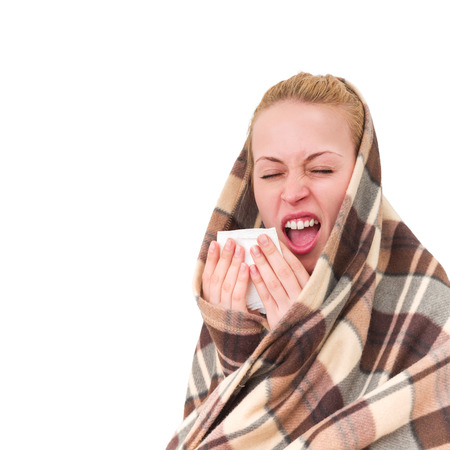 sneeze: A woman with a symptoms cold flu allergy wiping or blowing her nose