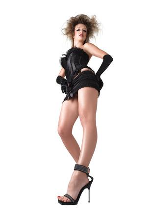 mini skirt: Belle jeune danseuse de night-club en mini jupe. Faible angle de vue