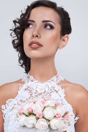 Beautiful young bride in luxurious gown portrait posing for studio photo