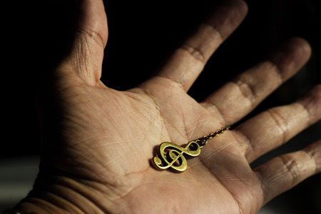 octaves: metal clef music in hand Stock Photo