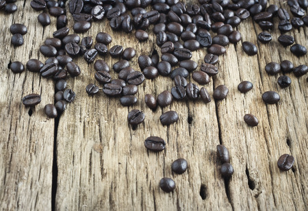 coffeebreak: Coffee beans on old wooden background