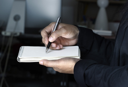 takes: Businesswoman takes notes in office