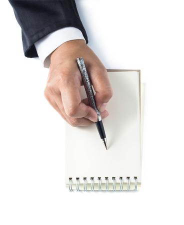 takes: Businesswoman takes notes on white background Stock Photo