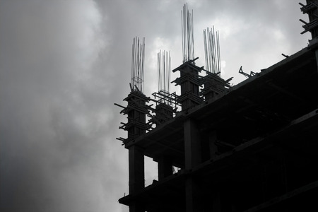 concrete structure: Building under construction at vibrant sky Stock Photo