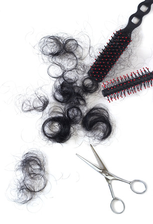 cut off: hair asian cut off scissors and comb on white background Stock Photo