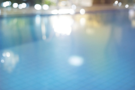 outdoor lighting: Abstract swimming pool at night  colorful and blur concept for background