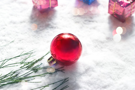 boxs: Christmas ball with green pine and gift boxs on snow background