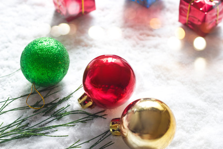 boxs: Christmas ball with green pine and gift boxs on snow morning background
