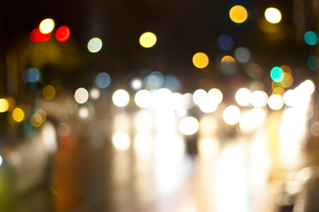 red traffic light: lighting cars on defocused in the road at night for background