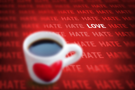 uplift: black coffee and heart symbol cup with words hate and love