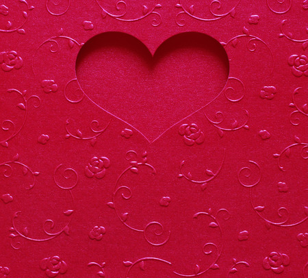 valentine card: red heart shape metallic color, card valentine on texture flower design Stock Photo