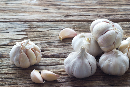 Garlic on the wooden background Stock Photo