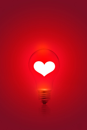 electric bulb: white heart shape on red light bulb background, blank text