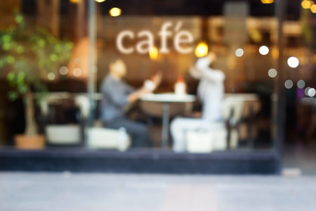 Abstract people in coffee shop and text cafe in front of mirror, soft and blur concept Standard-Bild